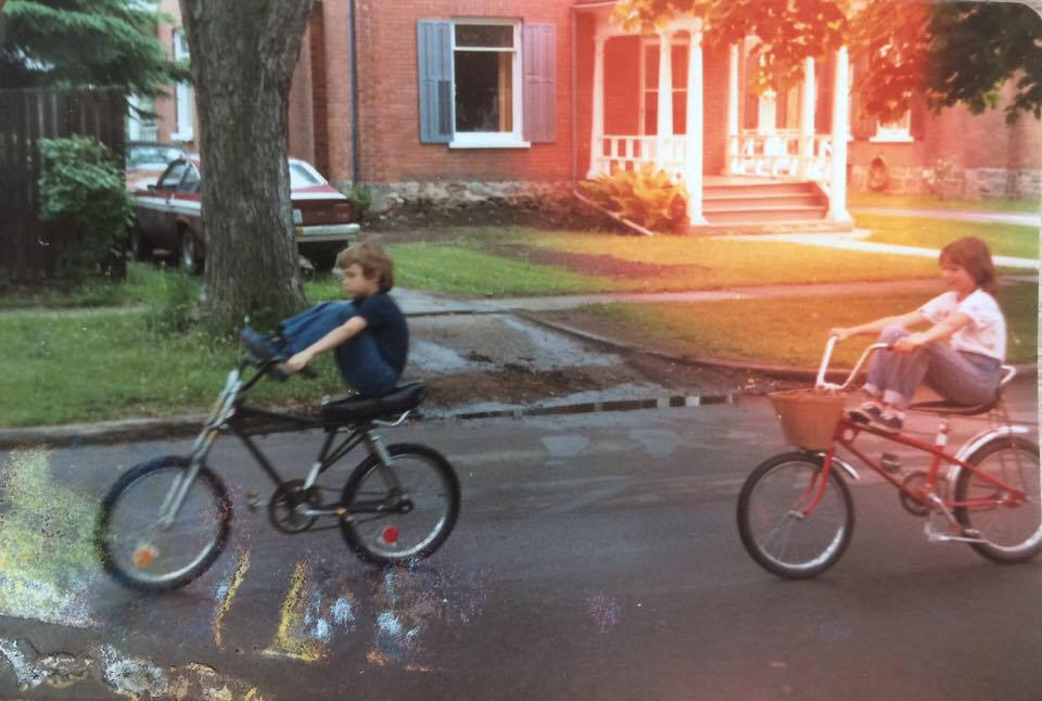 My brother, Dougie and I tooling around on our bikes on Homewood Avenue in Peterborough, Ontario, circa '81 -- the same bikes we would have thrown down on the sidewalk outside Parkway Variety.