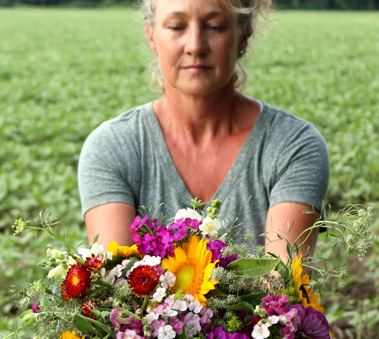 Farmer Kathy sharing the bounty of flower from the Farm with you . . .bouquets for special occasions and as well as hands on experience field to vase classes