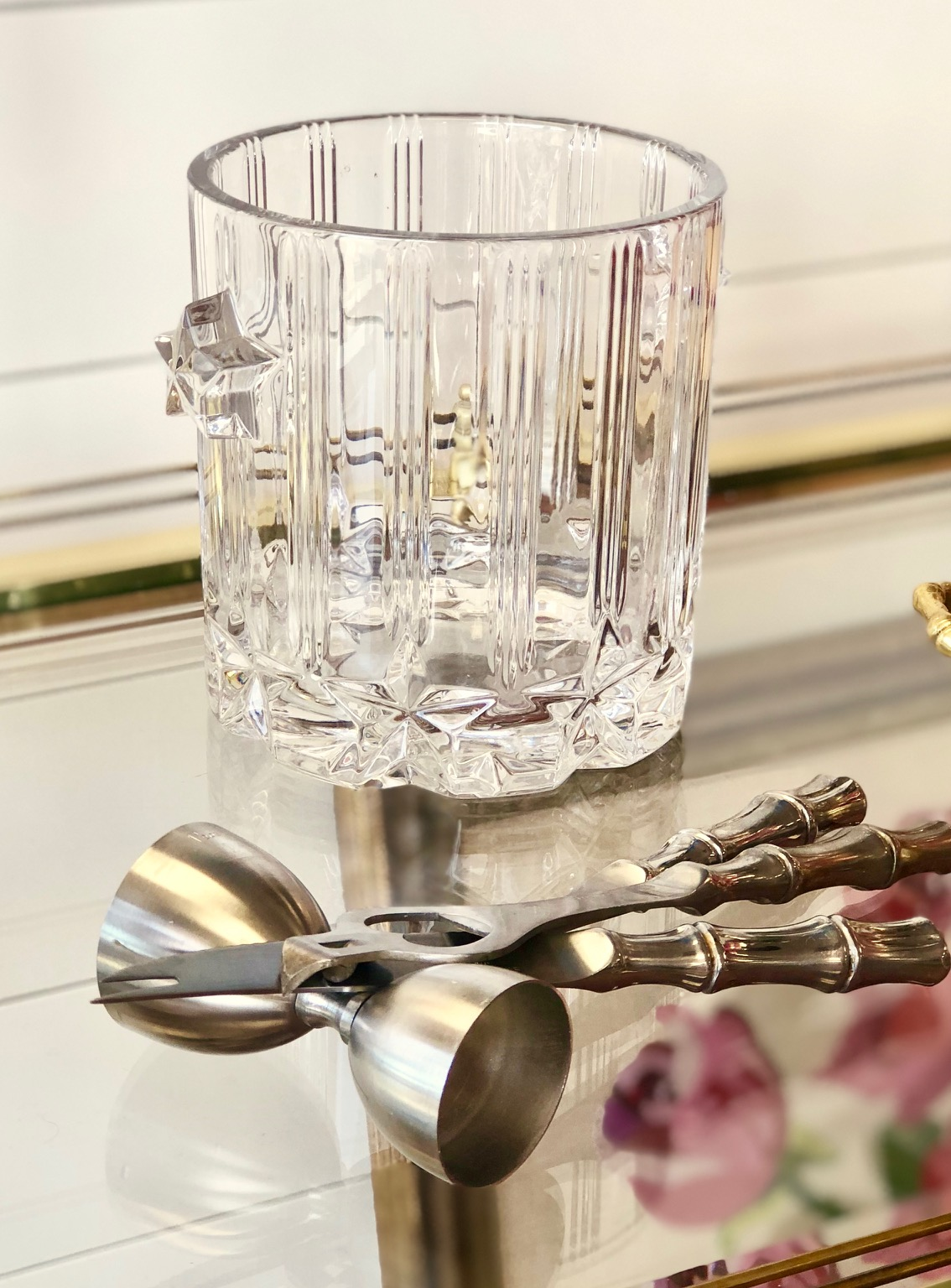 The red and gold chinoiserie glasses are begging for cool ice from the crystal ice bucket and the bamboo stainless bar accessories make it easy to measure and mix concoctions.