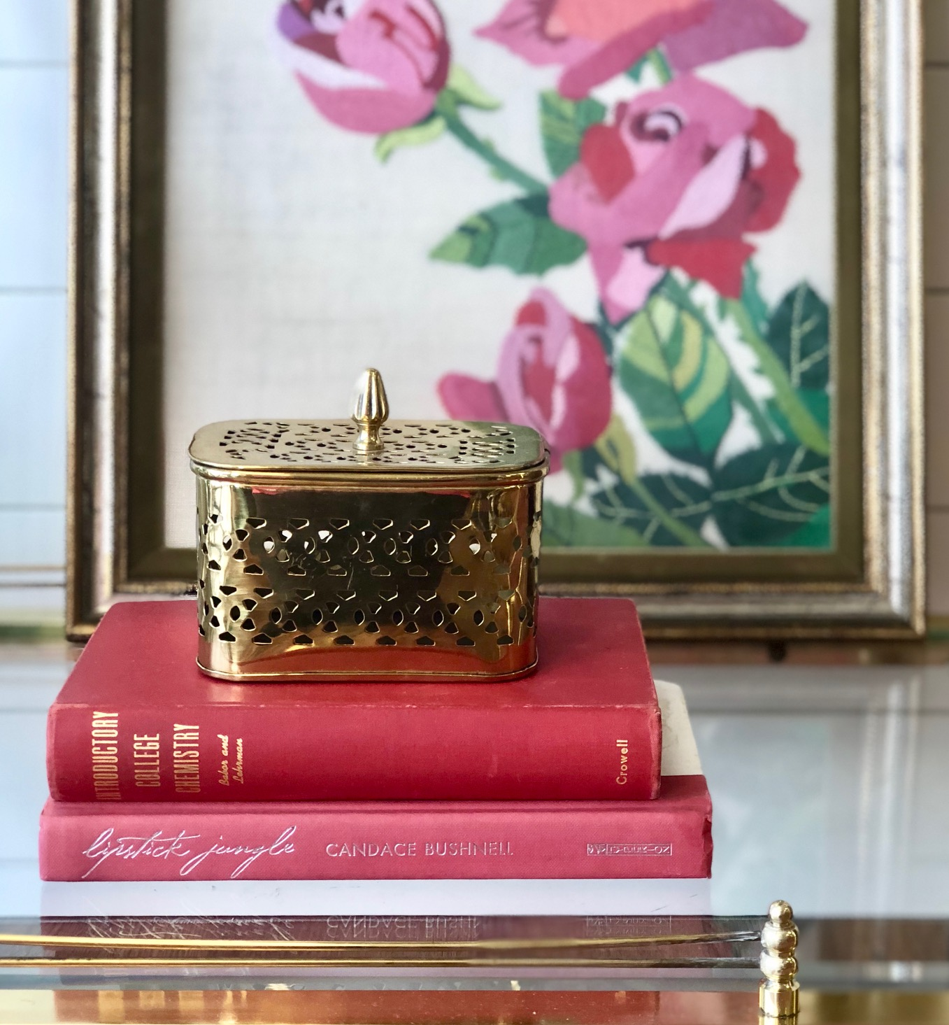 The brass cricket box makes storing matches for the candles above easy and discreet.