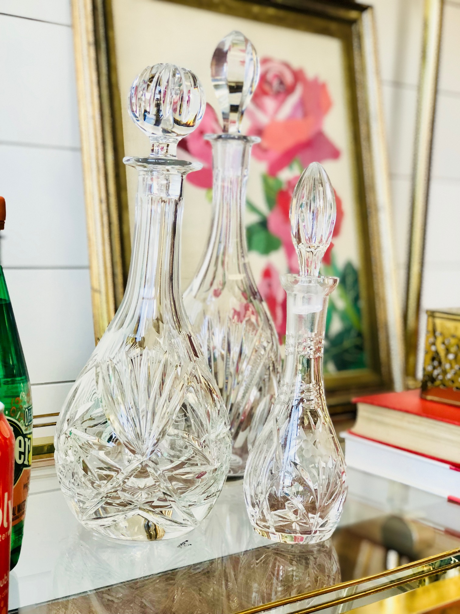 No bar cart is complete without crystal and glass decanters to offer a variety of drinks to guests.