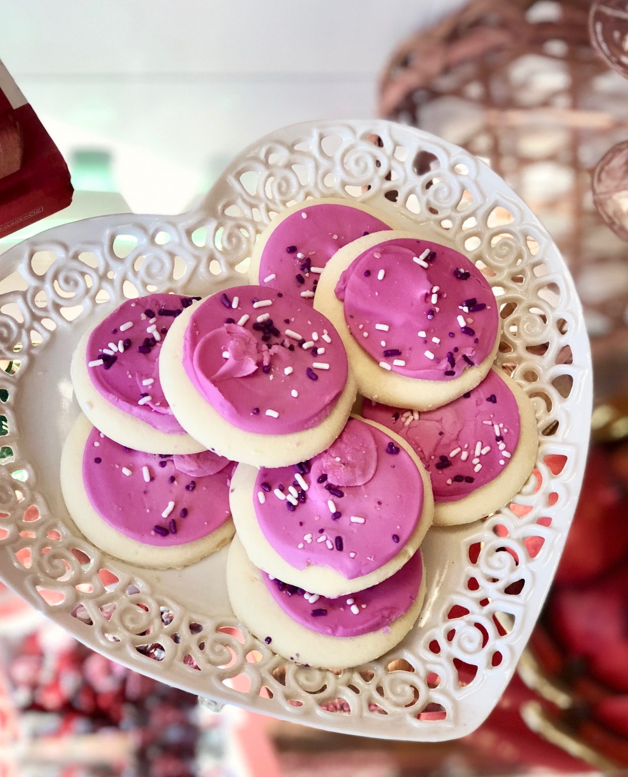 Sugar cookies on a delicate heart-shaped dish are a delicious finishing touch.