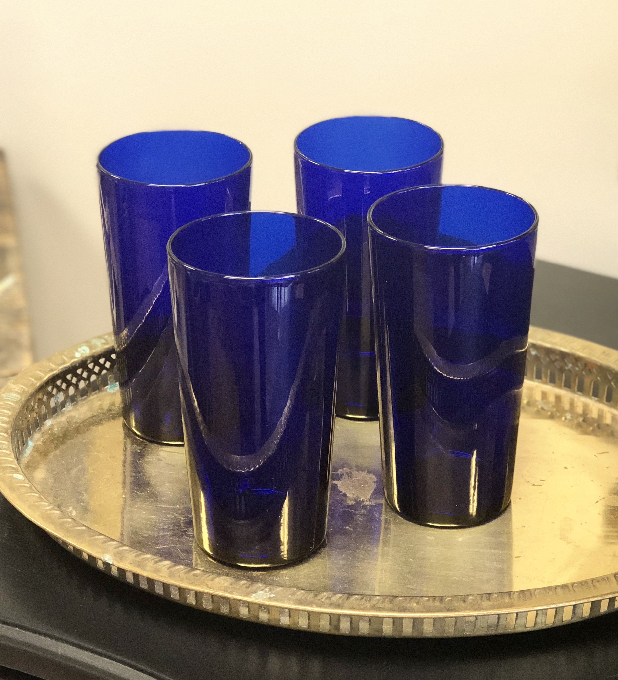 There's nothing more classic than cobalt high ball glasses on a brass tray.