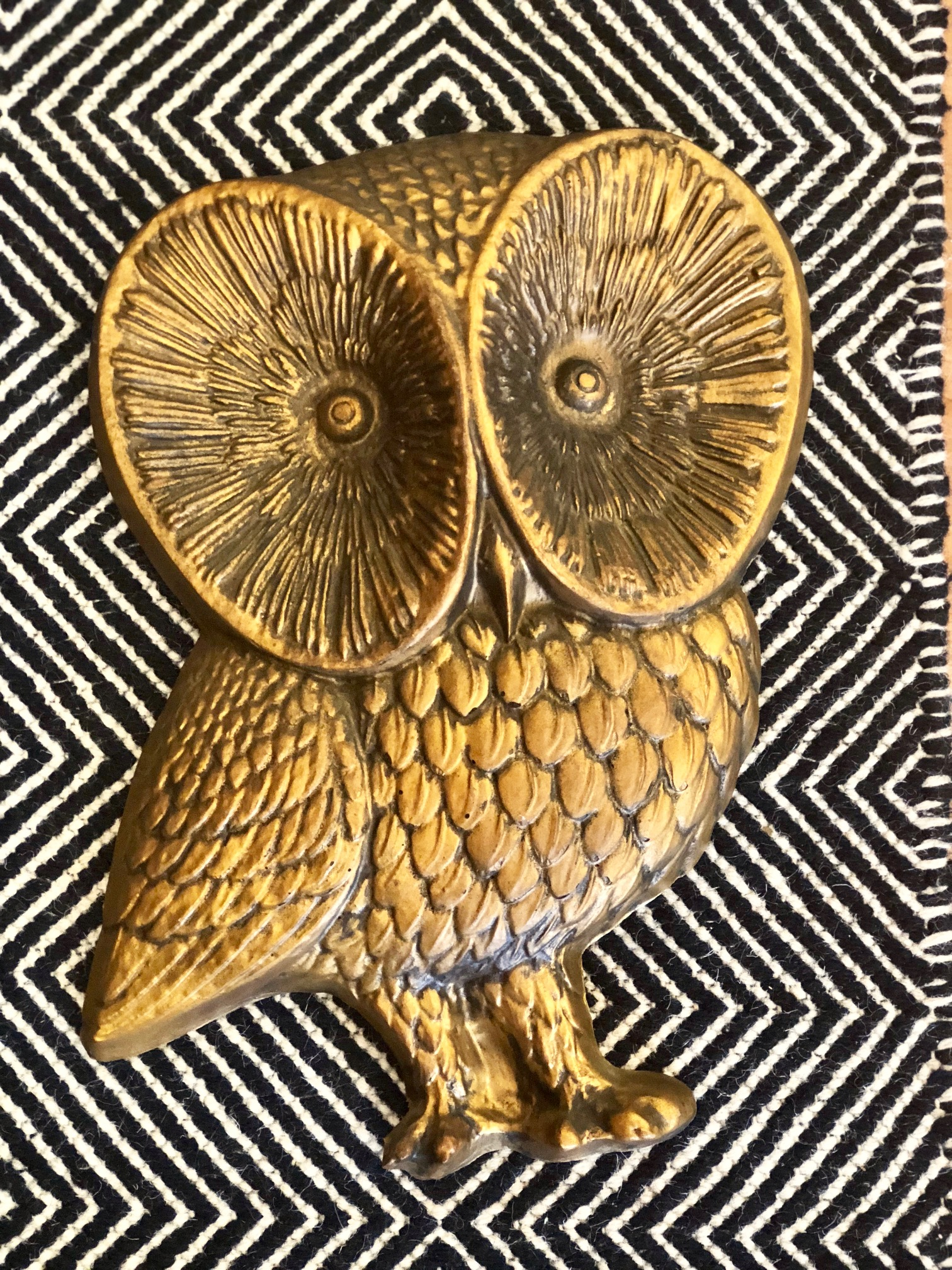 Pairing this gilded owl with a navy tone offers whimsical wisdom in your home.