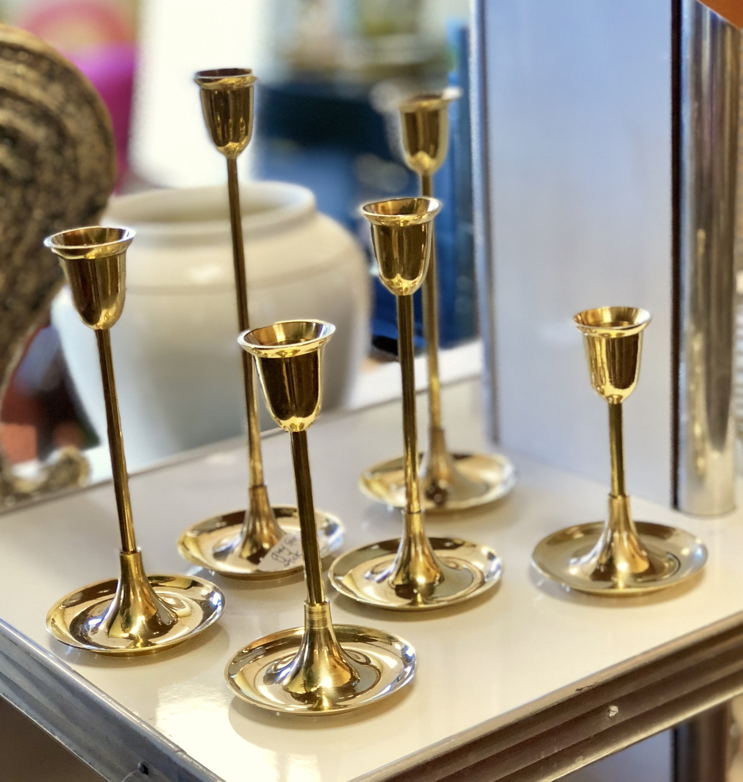 Imagine the candlelit dinner with this modern, pencil thin brass candlesticks glimmering with blue toned toppers.