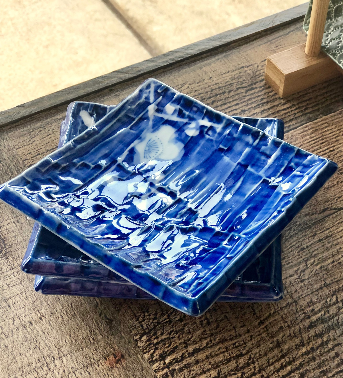 Handmade dishes in vivid azure add interest and conversation to your table.