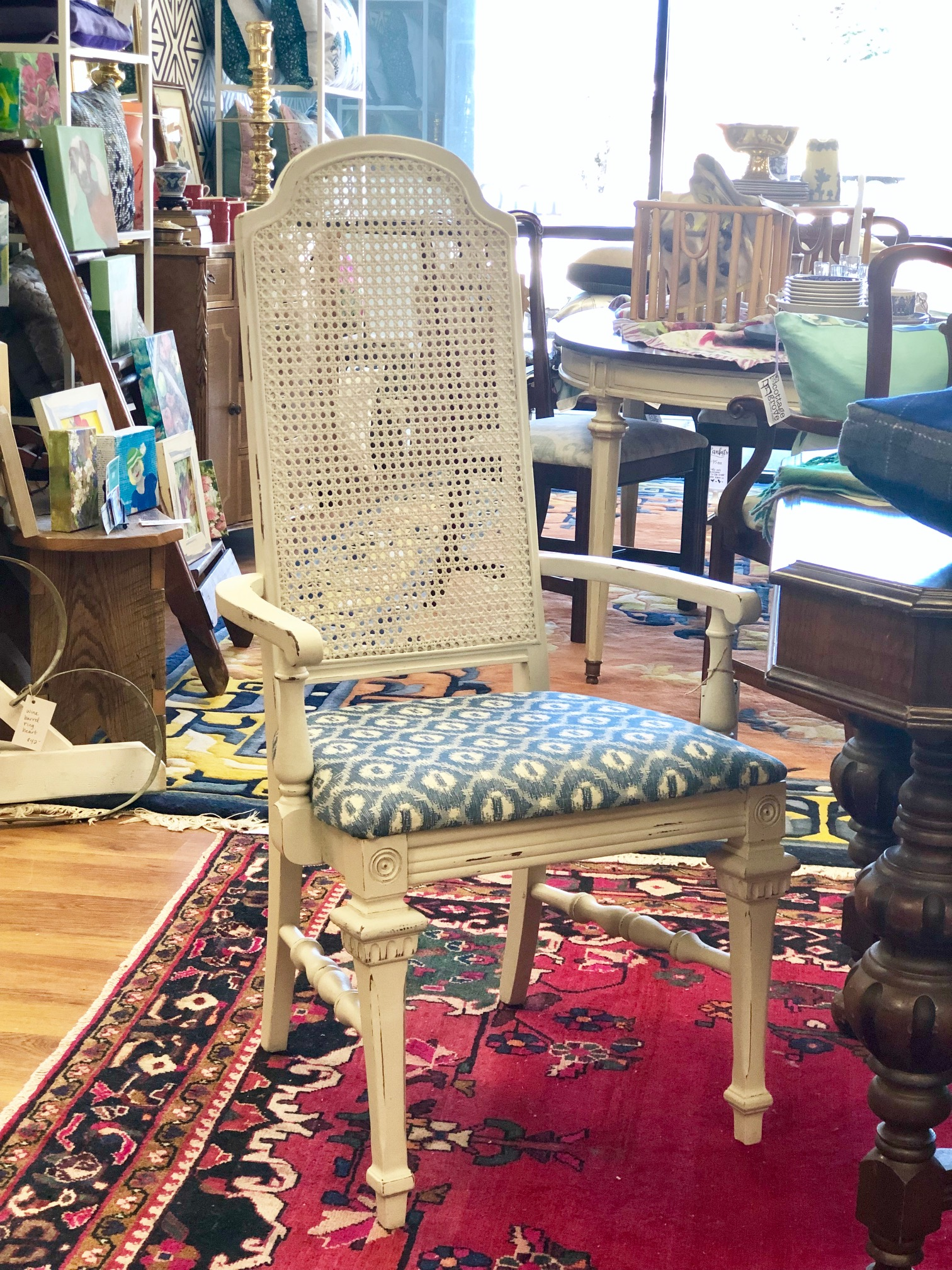 Cane back chairs with blue and white fabric from   Cottage Grove Vintage Market  .