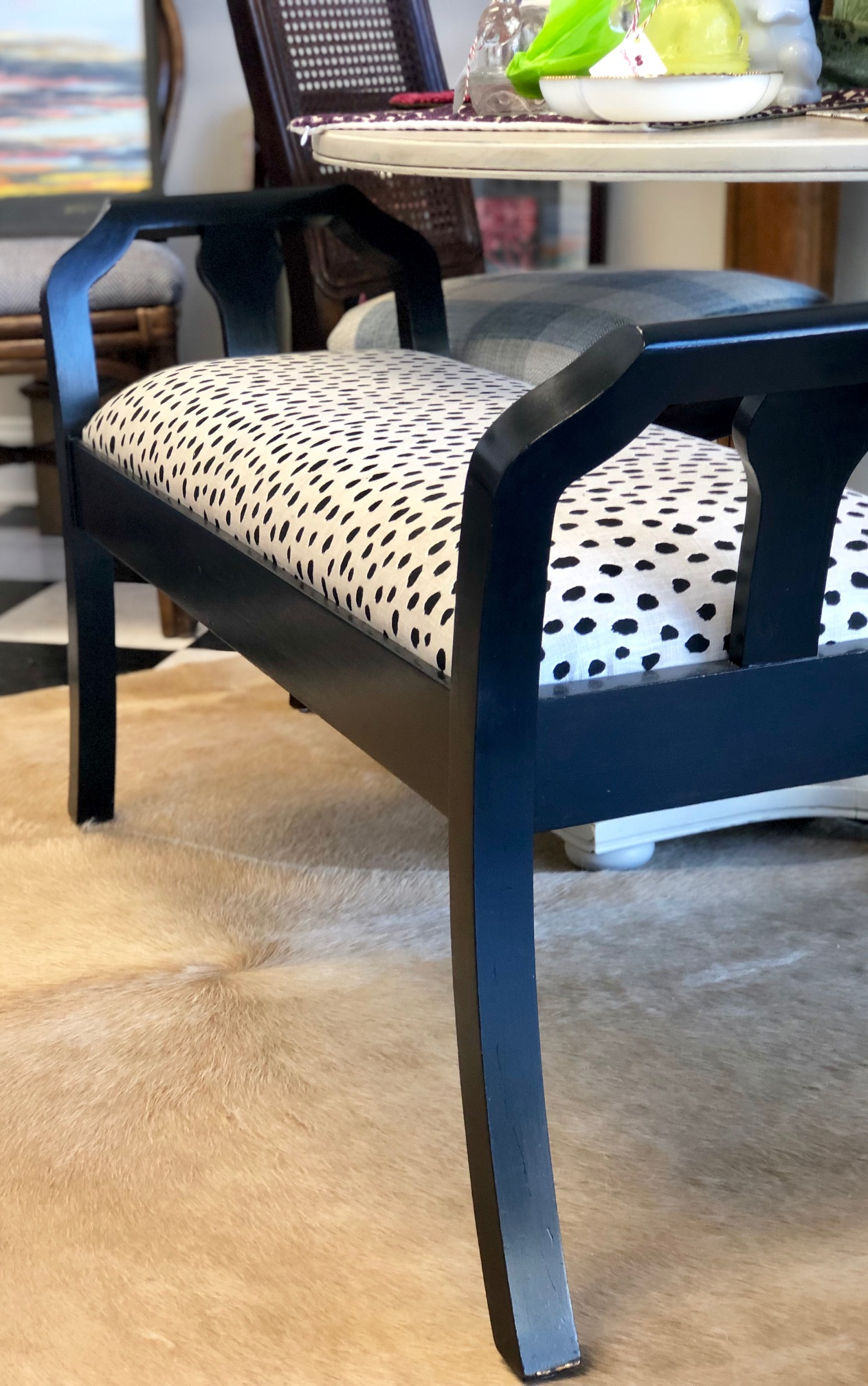 A dotted fabric updates this classic indigo bench.   Cottage Grove Vintage Market  .