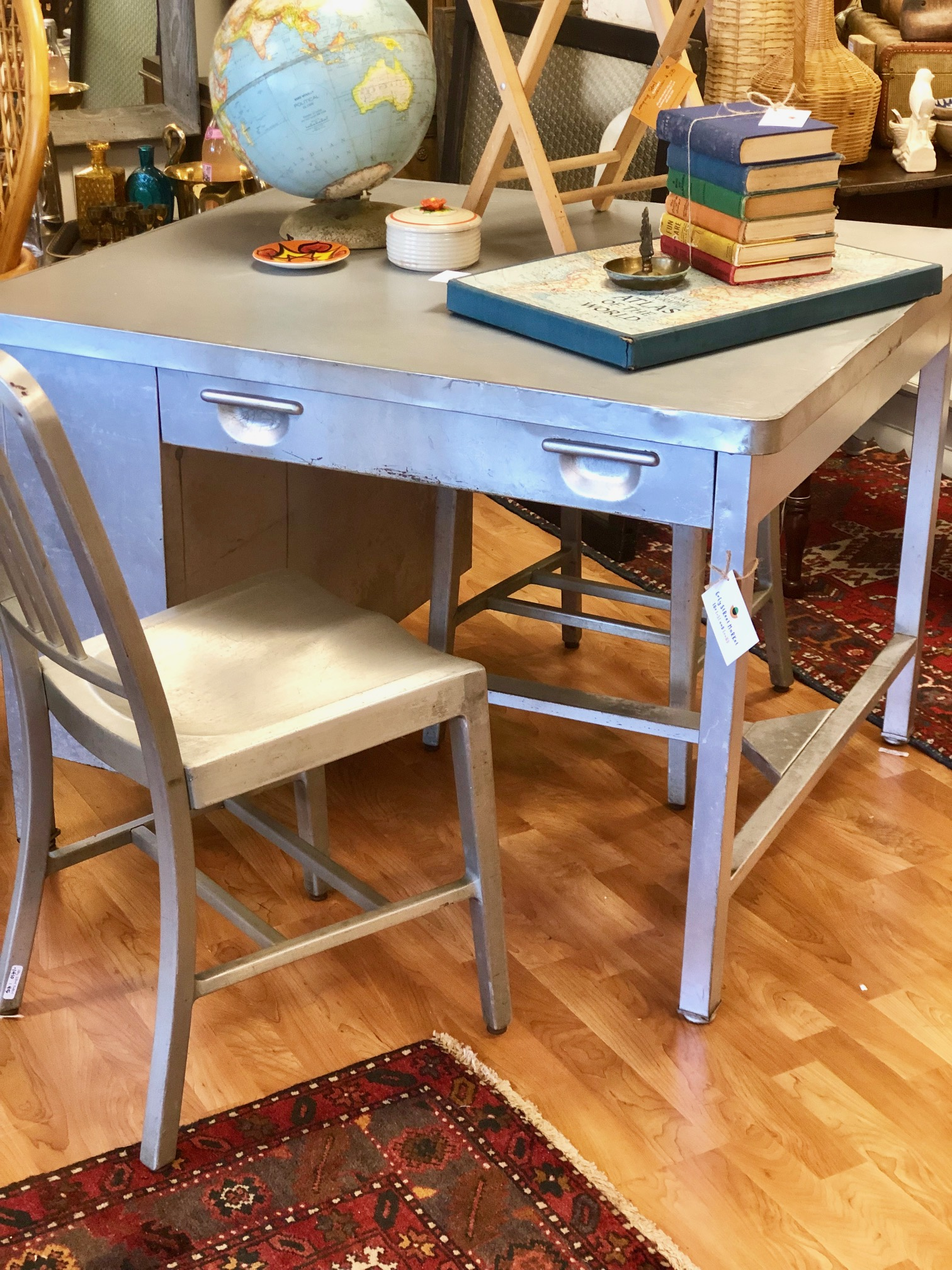 Double duty: a chair can pull up on each side of this industrial style desk.  $285  Grey Street Market
