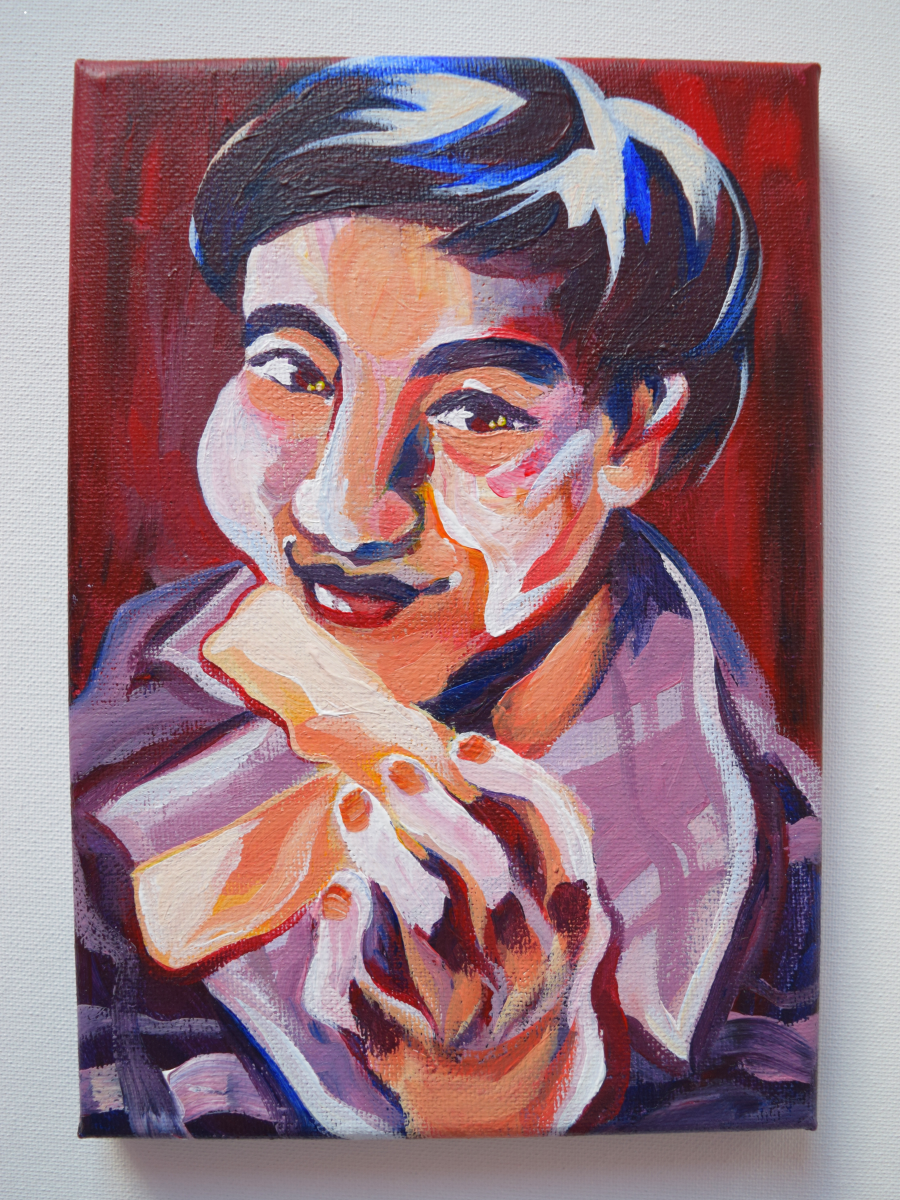 Painting of friend and fellow senior Angelique Nguyen with two egg rolls in hand