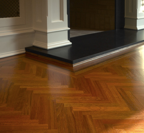 Herringbone Flooring - We specified and installed a new herringbone floor pattern with a black walnut feature strip. Nearly four thousand individual pieces went into this creation, requiring expertise and skilled craftsmanship, but the client was thrilled with the result as were we.