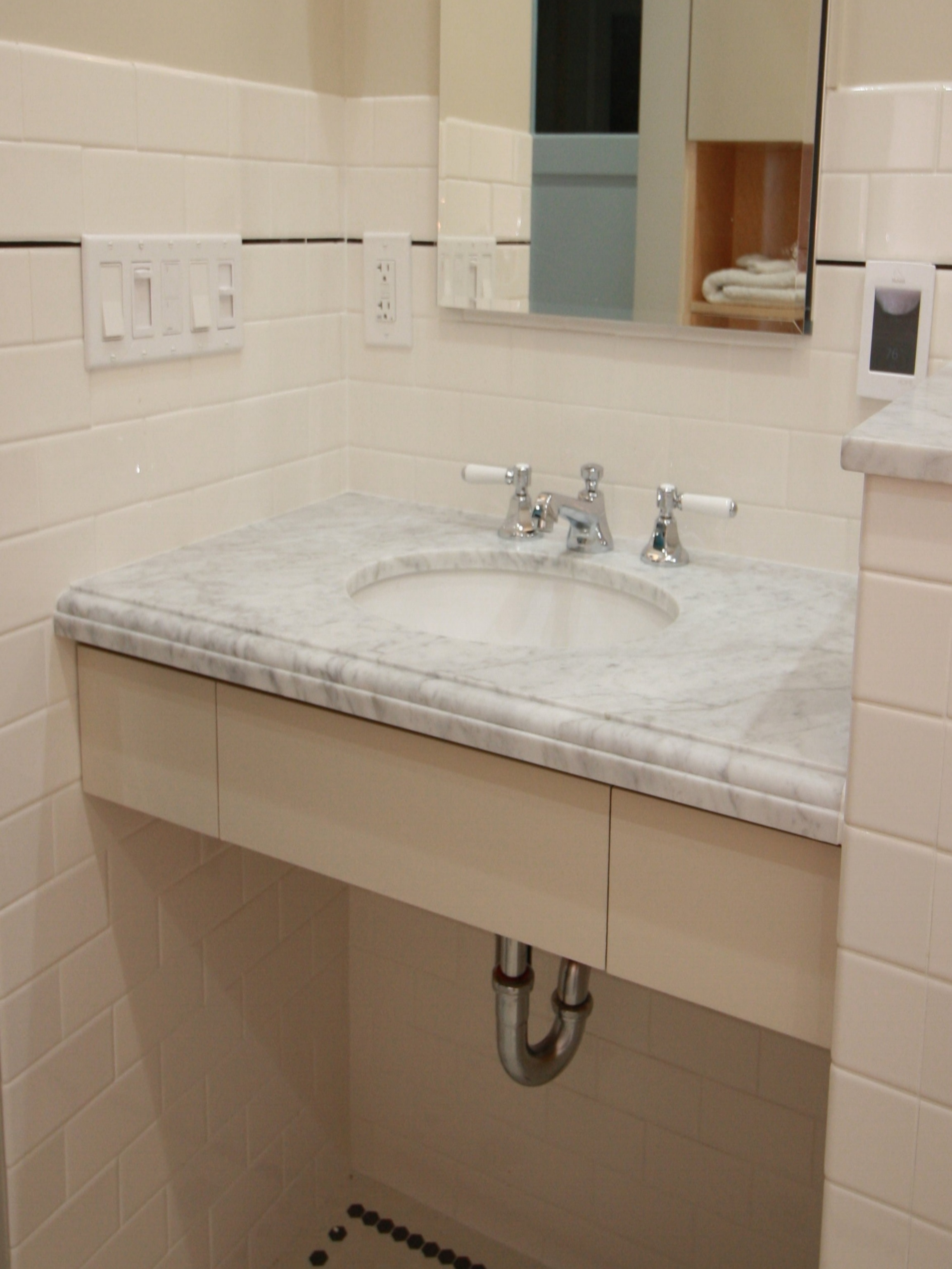Accessible for Anyone - A bathroom vanity that provides access for both standing or wheelchair users. Providing access regardless of their mobility helps us give back the  clients autonomy.