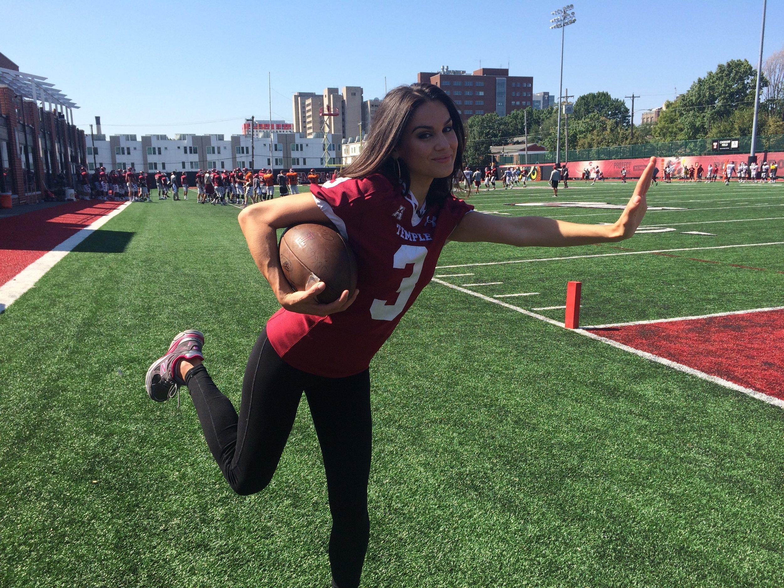 Nicole Brewer strikes her best Heisman pose, in honor of Temple's football team!