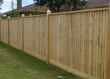 Flat top wood fence.jpg