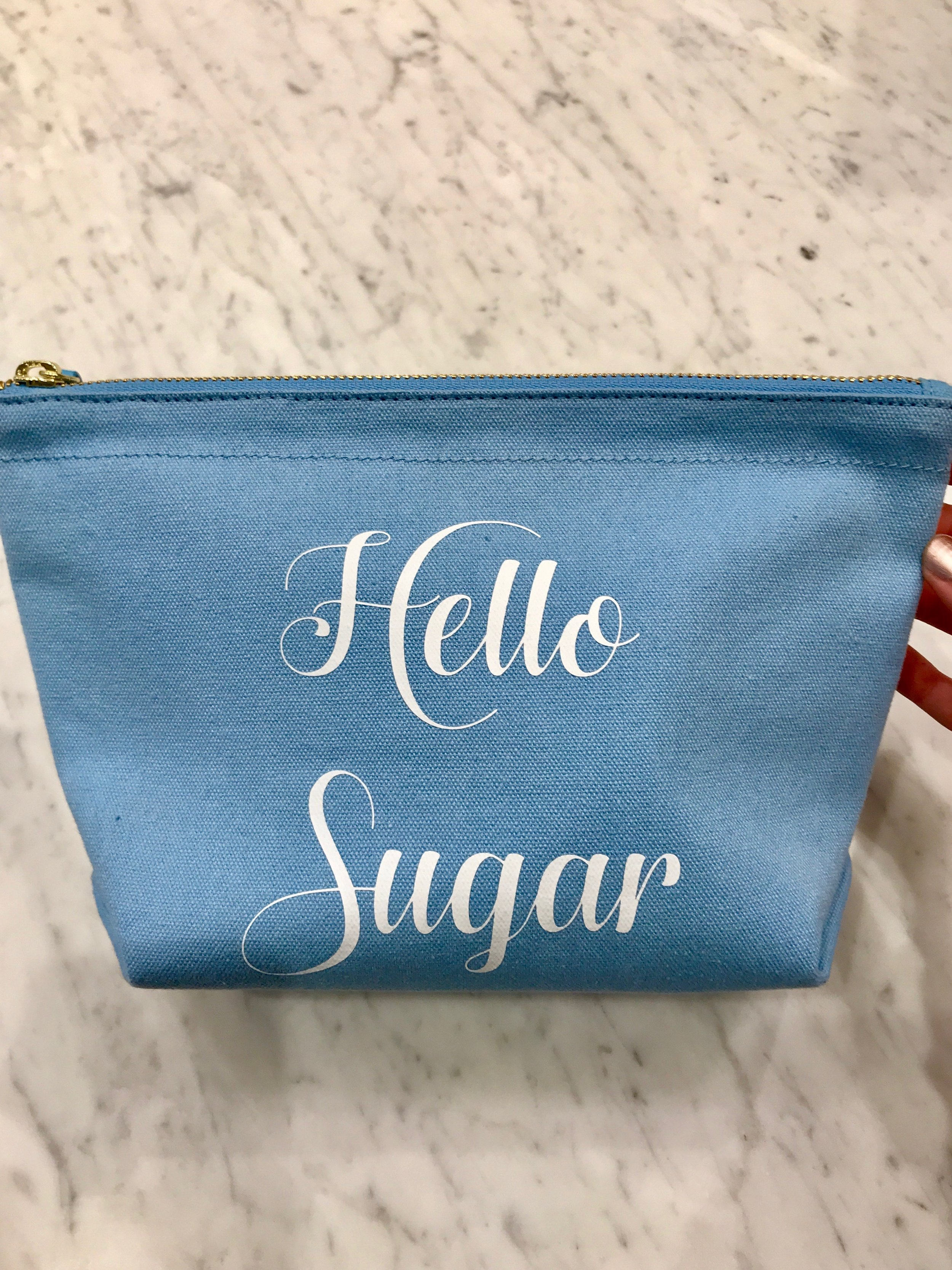 Makeup bag - $30 - Store: Draper JamesI personally love makeup bags (really any the of bag). I think this one is super cute and a great size. It comes in multiple colors and sayings. I love this bag because it can be used for a variety of things. It is also lined on the inside.