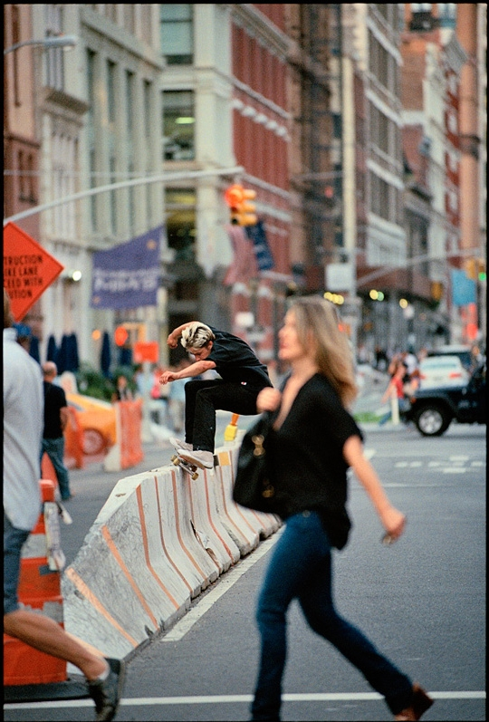 """Image by Allen Ying - The increasing privatization of public space has become one of the leading topics of debate in contemporary cities. The adoption of neoliberal economic policies has left many city governments with shrinking budgets, and even global finance centers such as New York have found themselves strapped for cash. Austerity measures meant to reduce public spending have been compensated for by an increased dependency on the private market to provide civic amenities that residents have come to expect. Many have welcomed this new era of public-private partnerships, some going as far as advocating for the complete privatization of all public spaces. Proponents argue that the private market offers the optimal framework for the provision of services, and that left to its own devices, will lead to more efficiently run public spaces while also allowing for innovative approaches that can produce exciting and novel situations. Their detractors argue that the private market will, by the very nature of capitalism, inevitably exclude more vulnerable social groups (without political or financial power) from these spaces, leading to increased inequality in how different people experience their city.However, both sides of this argument miss how inclusionary practices regarding public space can be used not just to facilitate equal opportunity, but also to encourage equalizing outcomes. Alvaro Sevilla-Buitrago's 2013 analysis Central Park Against the Streets counterintuitively suggests that one of the most iconic 'commons' in the world was in fact conceived as one of its greatest enclosures. """"The case of Central Park shows that institutional orderings of space can incorporate subtle, often unnoticed strategies of dispossession without privatization, using certain assemblages of public space to eradicate the practices underpinning autonomous appropriations thereof."""" Rather than simply exclude increasingly unruly working-class visitors from their park, Vaux and Olmstead aim"""