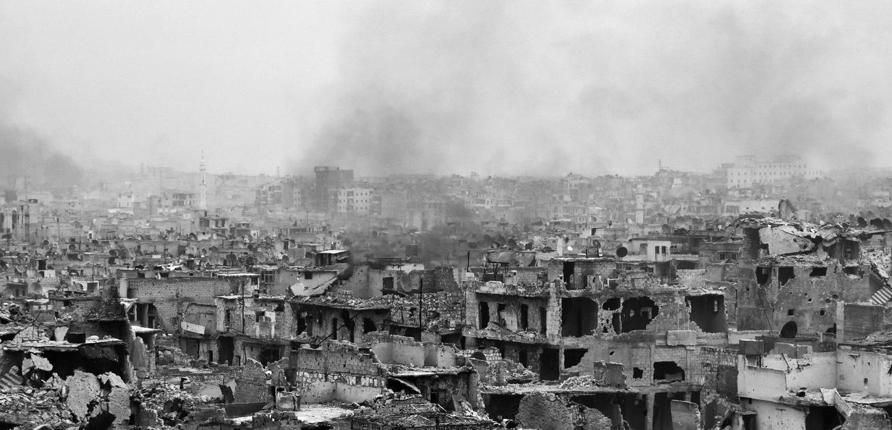 """Ourfalian, George.  """"The Al Shaar neighborhood lies in ruins as Syrian pro-government troops advance through the Karm al Jabal district during theiroffensive to retake Aleppo """", December 5. Los Angeles Times."""