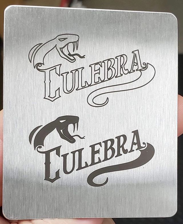 We are getting some engraved neck plates for our 6 string guitars! Here's a sample. Which do you like better? Outline or Solid?