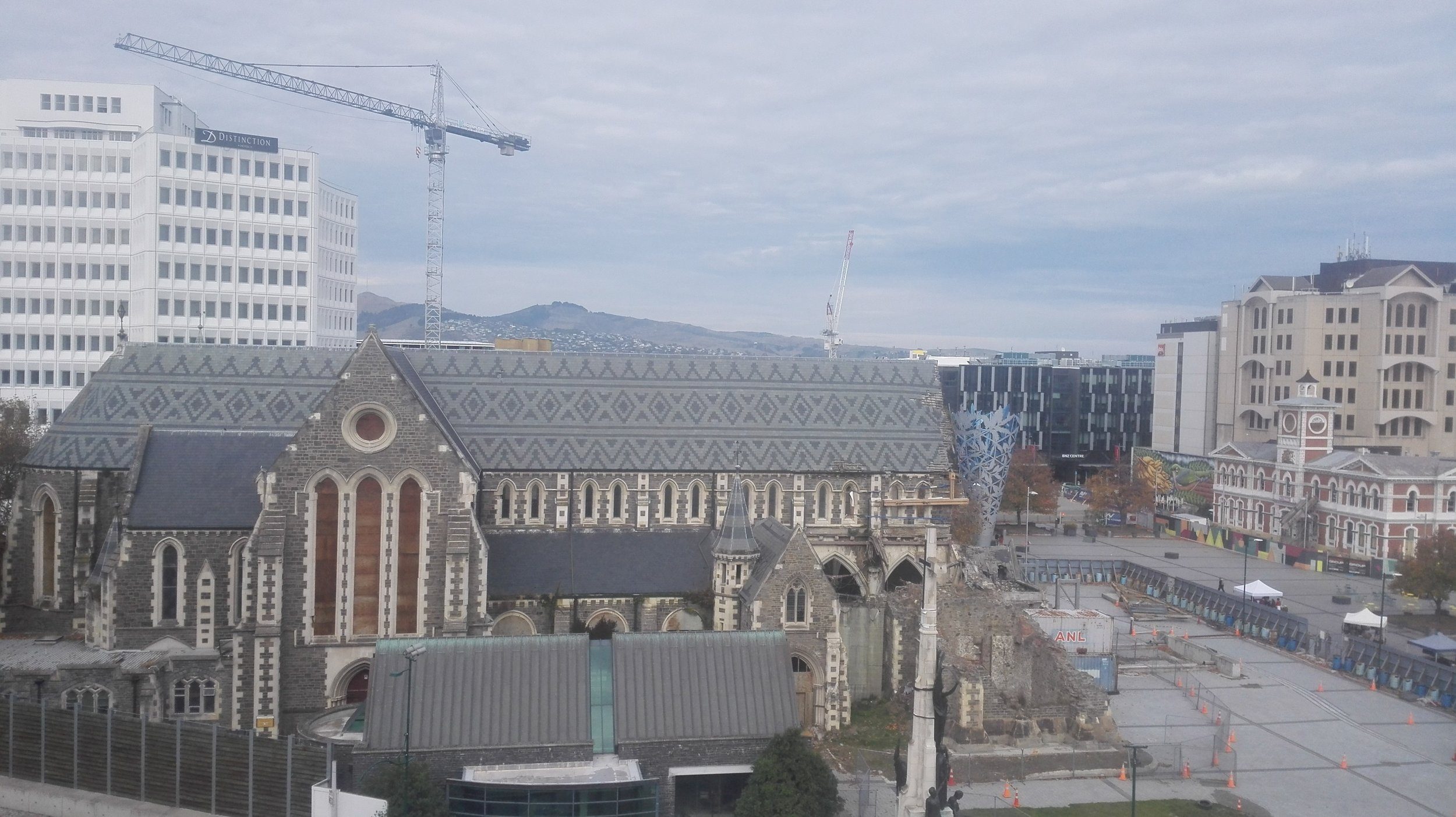 Looking south from Christchurch Central Library over the cathedral towards the Port Hills