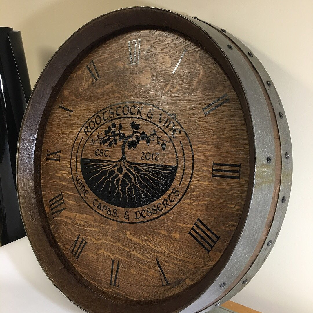 What do you get the wine enthusiast who has everything? A vintage wine barrel clock with a custom logo.