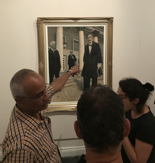 Artist Ramon Esteban Rivera Caliz (left) tells the story behind his painting in the Museo de Ponce.