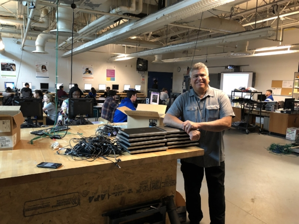 Melvin picking up the donated laptops for Puerto Rico at VA STAR's workspace.