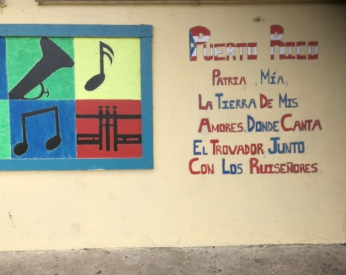 "A mural from Escuela Angel ""Papo"" Diaz Colon in Orocovis where Marci visited with NetHope.  It reads, ""Puerto Rico, my homeland, the land of my loves, where the troubadour sings, together with the nightingales."""