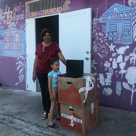 """""""Tata"""" and her granddaughter receiving laptops"""
