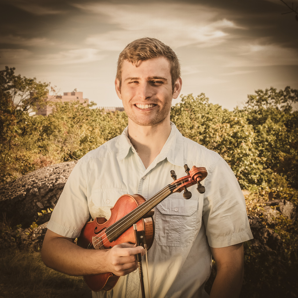 "James Hanfordon Fiddle   - He's played violin ""for as long as I can remember"" and the proof is in the playing. In addition to the fiddle, James plucks the mandolin and banjo, and was a finalist for the 2017 Freshgrass Banjo Award. In his younger years, James performed in an award-winning string quartet and several orchestras, and recently had a guest spot playing banjo with the Milwaukee Symphony. He used to play a lot on the TV until his mother made him get down before he broke the thing. James came to Boston after graduating from an engineering school in upstate New York, and now hangs his hat in Alston/Brighton.Quote:"