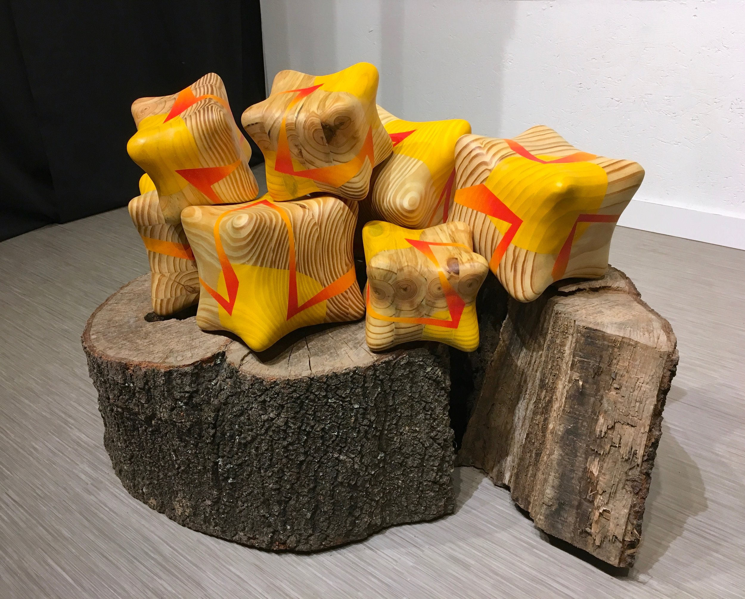 """Campfire , Pine, spray paint and found tree stump, Approximately 36"""" wide x 26"""" deep x 24"""" high, 2017."""