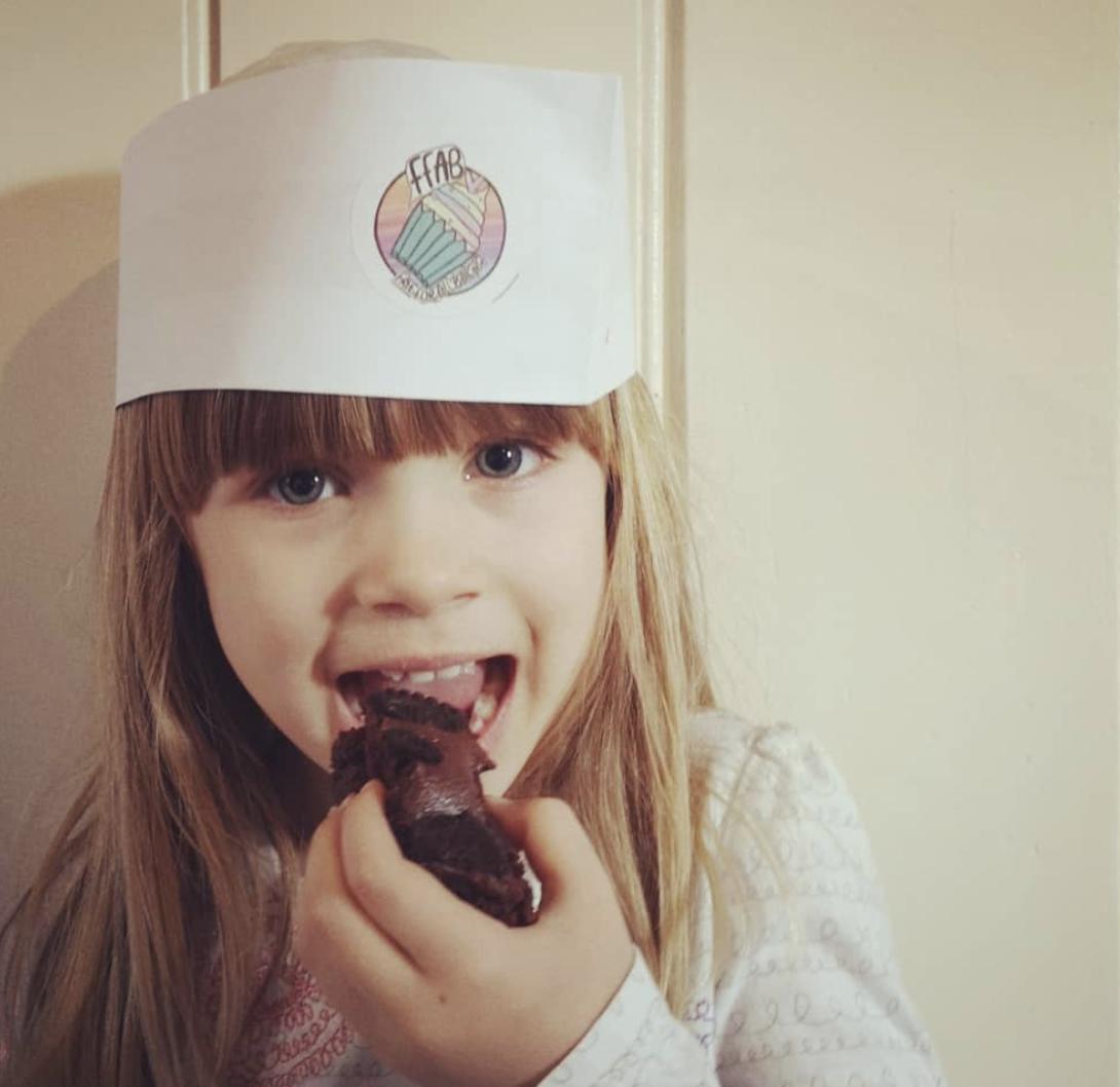 Amalia enjoying some allergy friendly baking. Picture: Instagram @freefromfarm