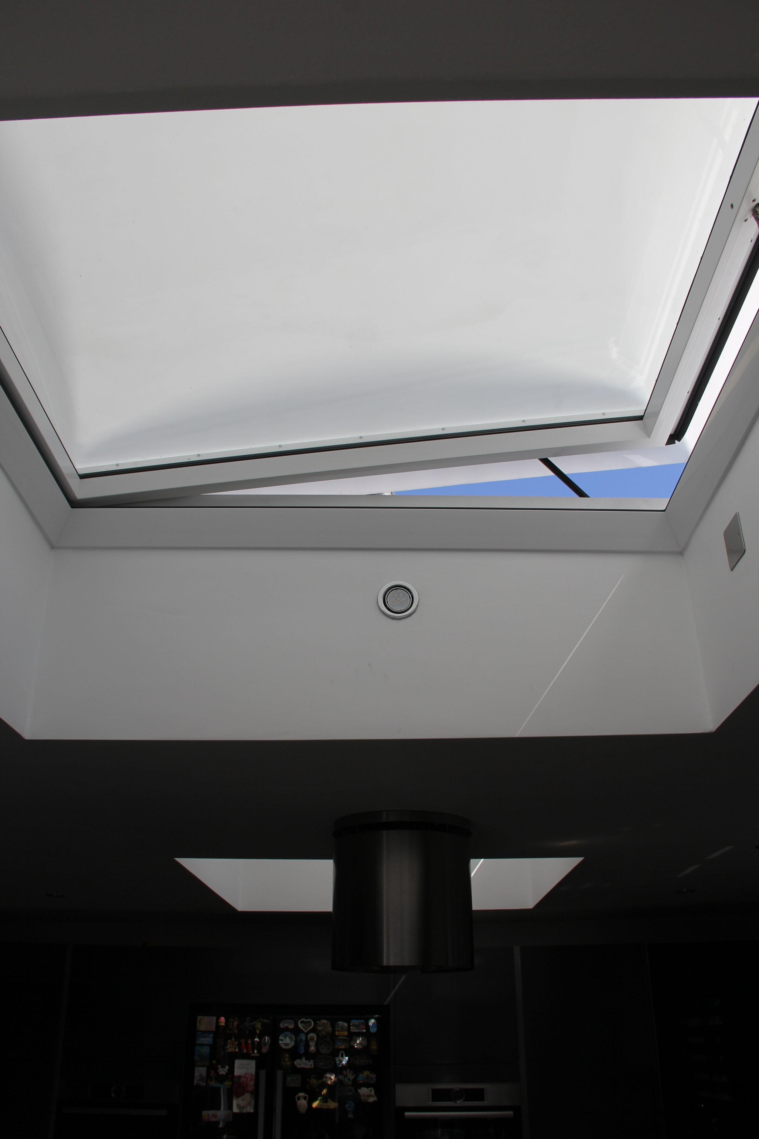 Electric rain sensor roof light to rear extension.JPG