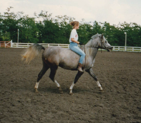 Kristen and her first horse, Gottanya