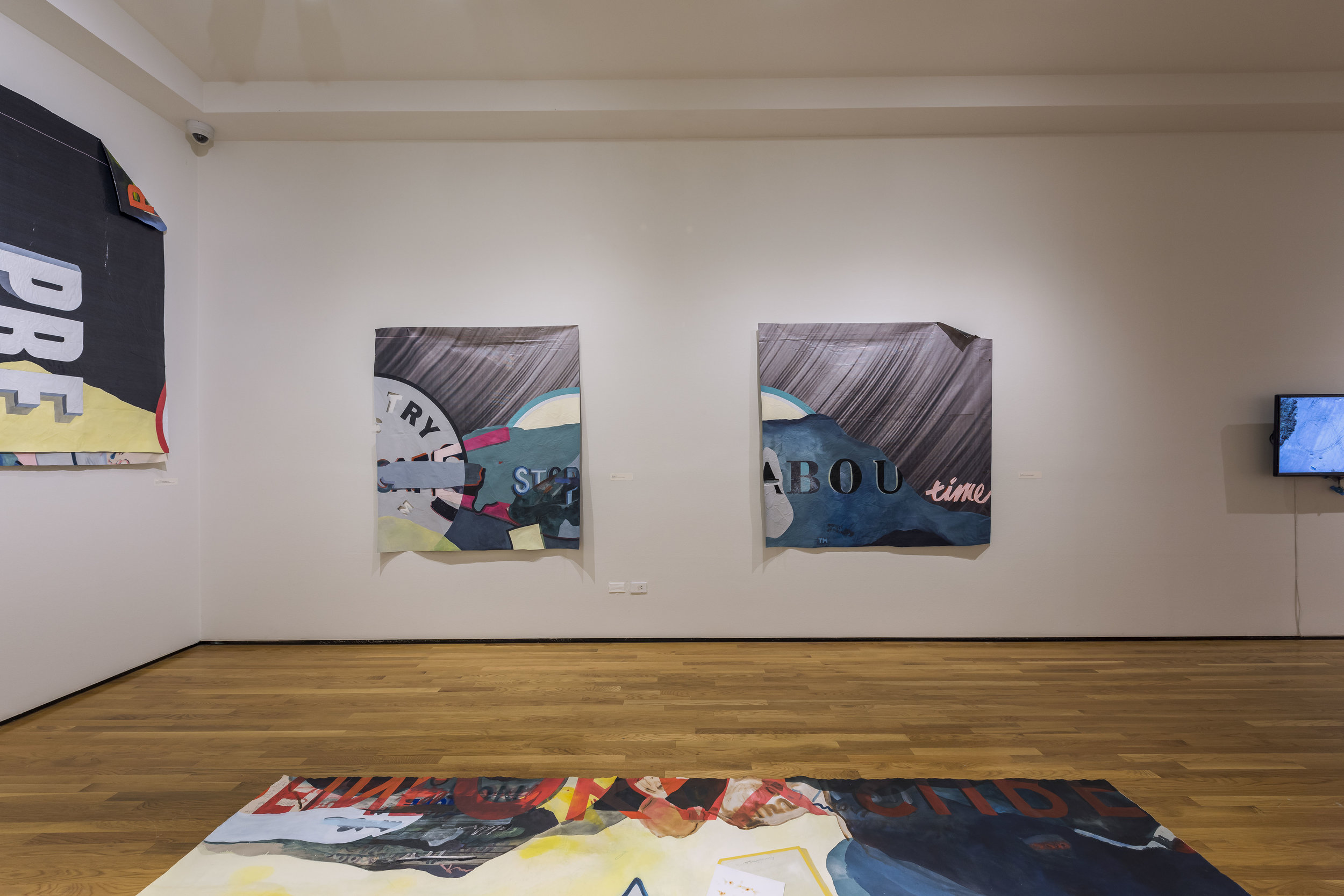 installation shot of:   safe , 2019, enamel, acrylic, oil, and paper on repurposed billboard (left)   tm , 2019, enamel, acrylic, and puff paint on repurposed billboard (right)