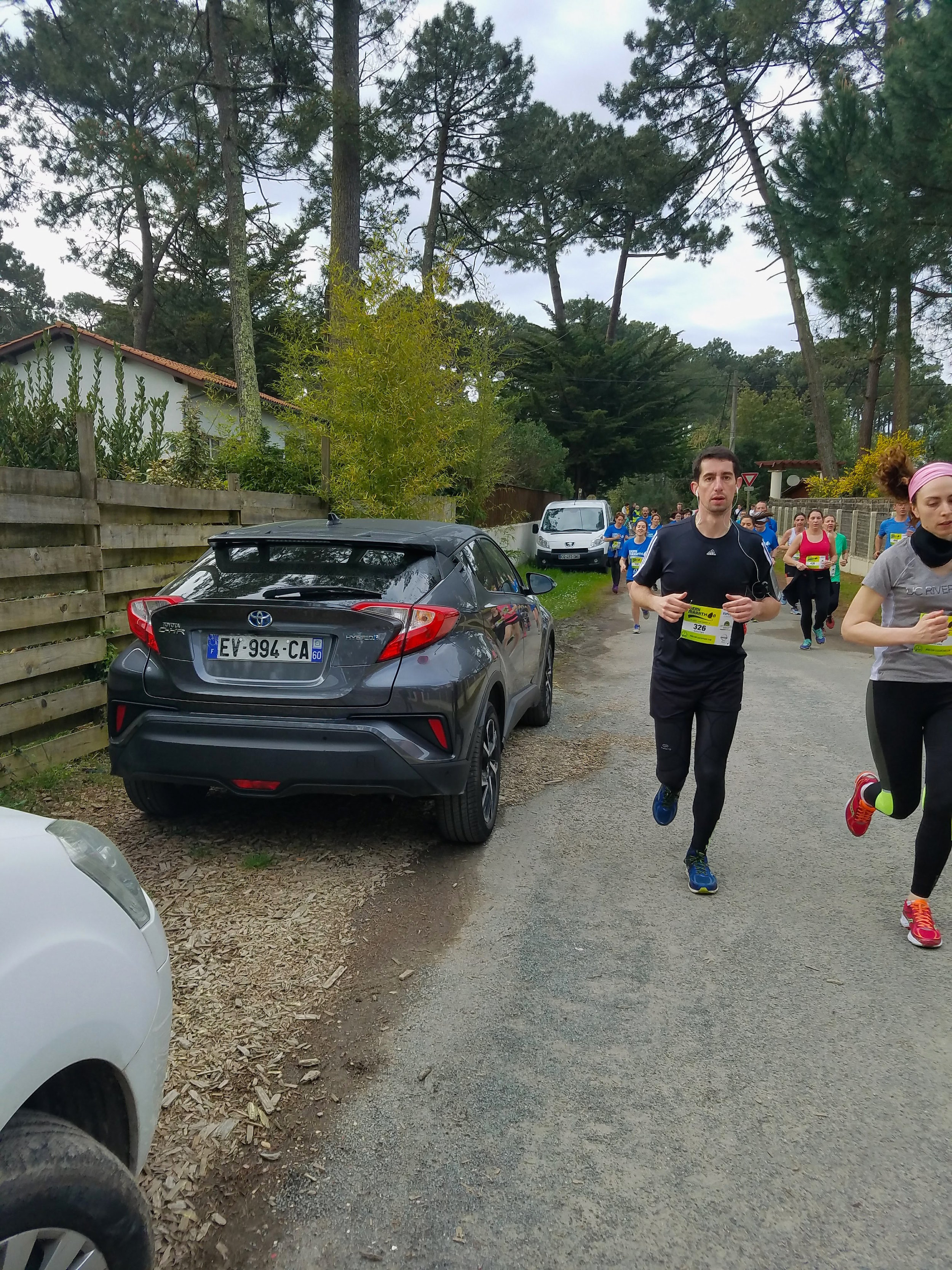 THAT'S OUR CAR. And a confused runner wondering why were so excited at kilometer .5.