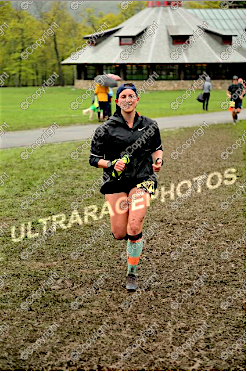 In hindsight, I feel a bit strange about all these photos of me smiling at the finish line. I feel that I look relieved and sheepish, instead of strong and proud. (Dare I say: badass?) In a way, I feel that I took the advice of the spectators to fit their image of what a finisher looks like — but not how I view myself. I feel that I look like a stranger here.