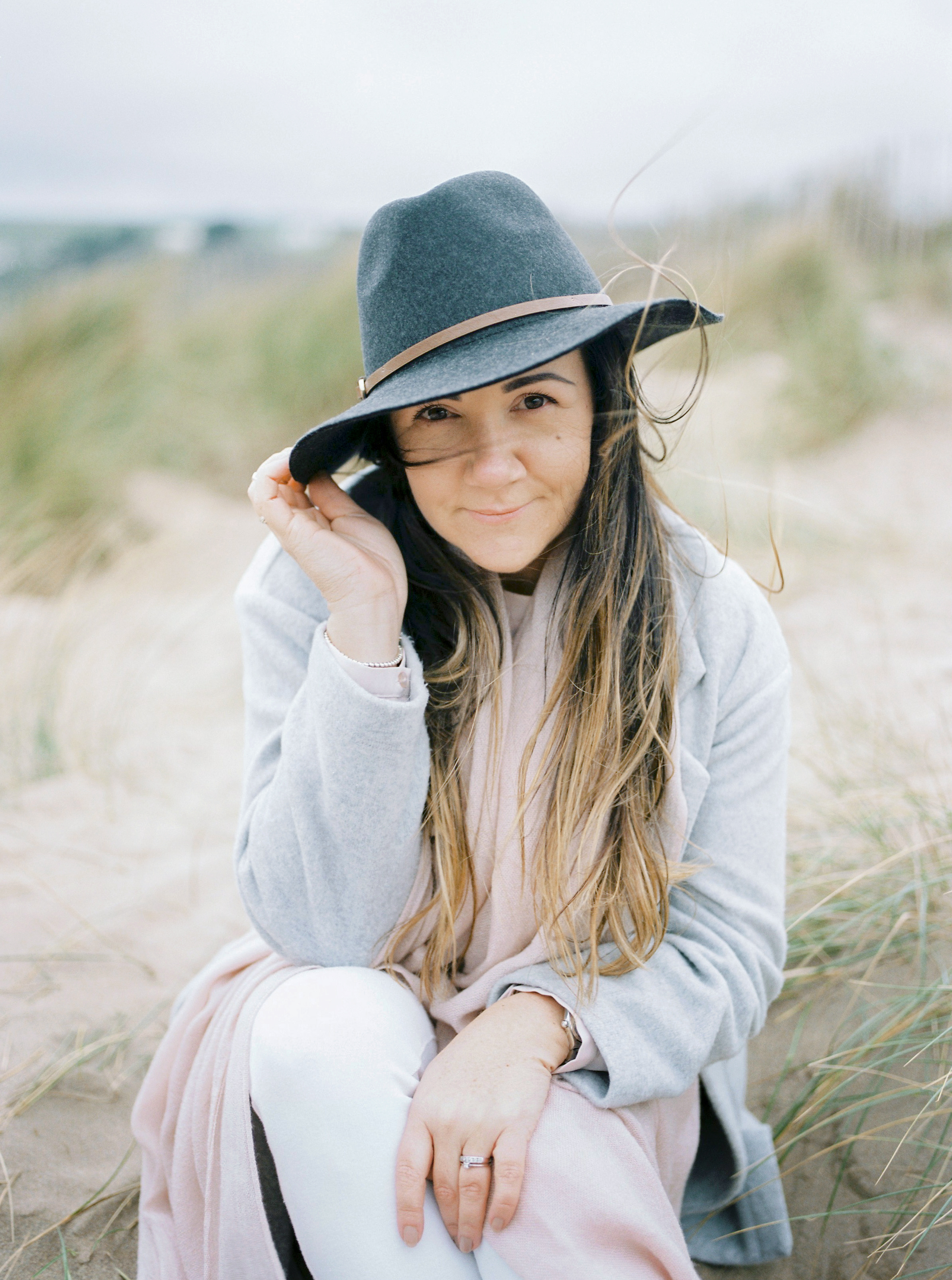 About Katy Jones - I'm a Devon based Photographer (that's me in the hat), living just south of Exeter by the seaside. It's a privilege for me to document moments in your lives. To be a part of something special just for a brief moment in time. I love what I do; getting to know you, making connections and of course shooting photos.I like fresh coffee and new shoes, stationery and organising stuff and I'm obsessed with succulents. I love feeling sand between my toes, getting the giggles with my daughter and being inspired to travel and try new things.I don't like cheesy poses or making anyone feel awkward. I also don't like coriander or magic tricks. I'm not even sorry.If any of this is a bit of you, drop me a line. I'd love to hear from you!Photo credit | Irena K