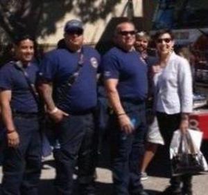 Sarah with firemen.jpg