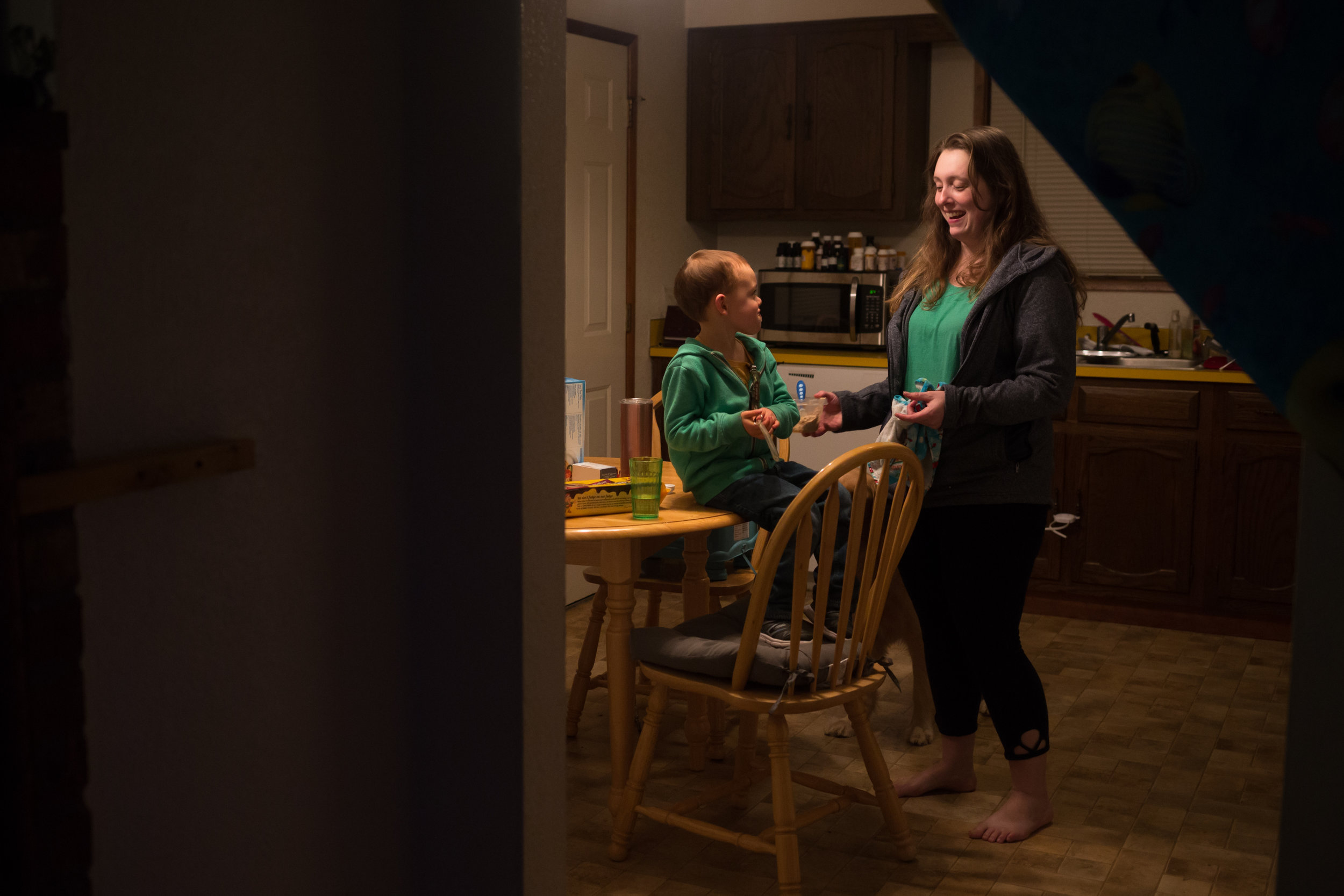 James and Paige enjoy dinner at their home in Springfield, Oregon. Paige, a single mom,works two jobs as a an inventory manager and production worker at a local warehouse to support her family.