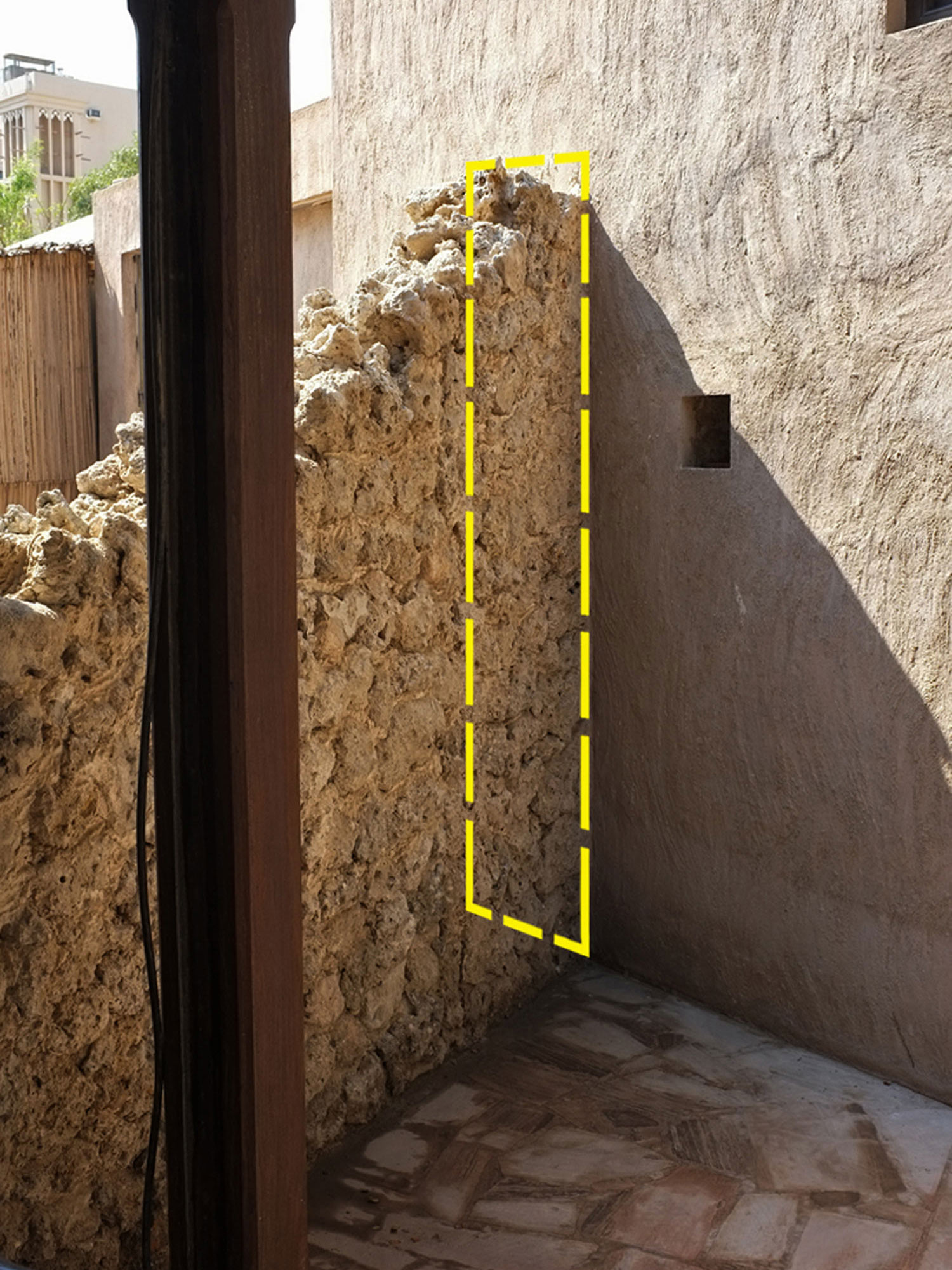 Preserved section of Historic Boundary wall  Al Fahidi Historical Neighbourhood  Highlighted in Yellow are the cross section dimension measuring 250cm (h) x 40cm (w)