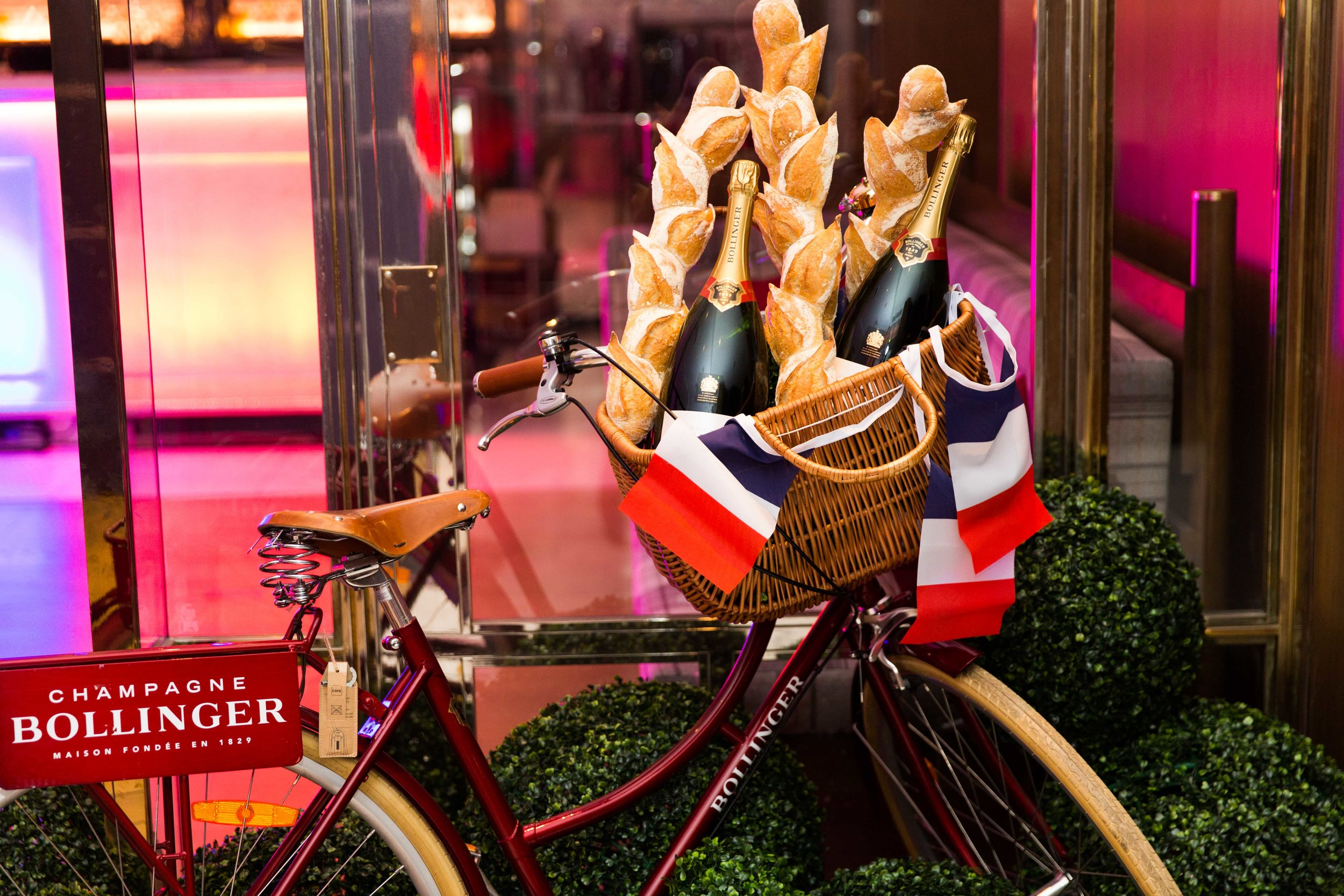 Bollinger champagne in a bicycle basket
