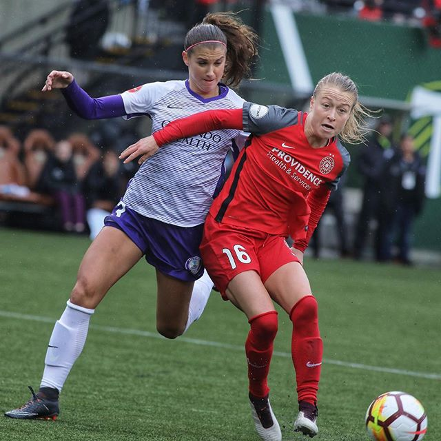 USWNT teammates Emily Sonnett and Alex Morgan fight for the ball, as the Thorns win their home opener. #baonpdx #uswnt