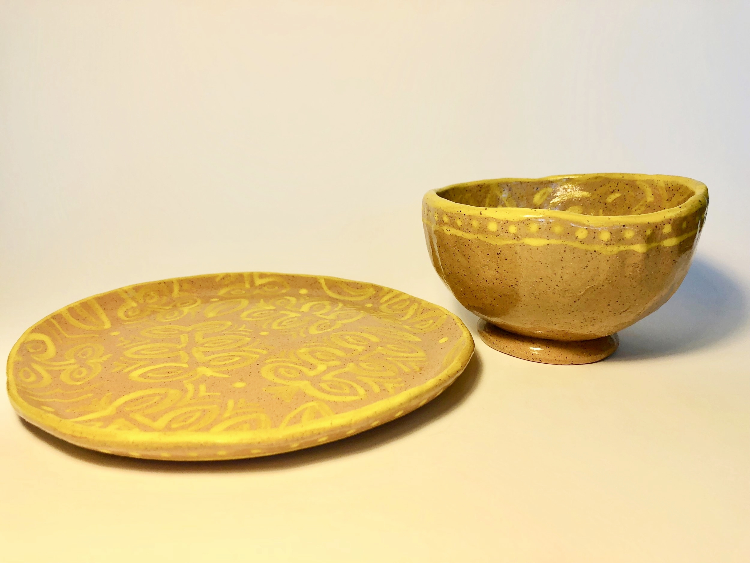 Hand-painted plate and pinch pot bowl in yellow