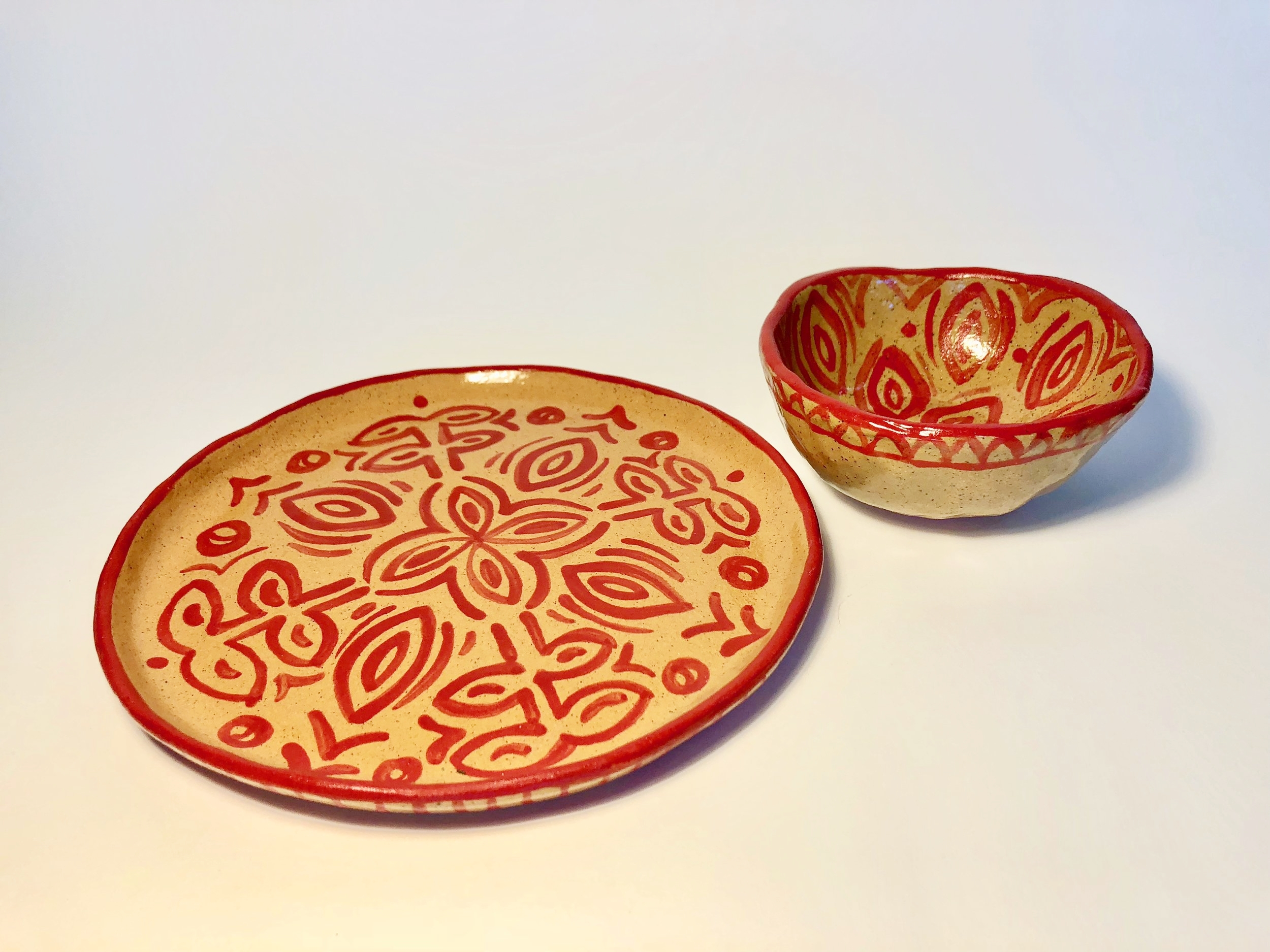 Hand-painted plates and pinch pot bowls, available in a variety of colors.