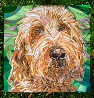 This is a stained glass portrait that Susan made of her other dog, Theo and then she wanted to do a pet portrait of Kodi.