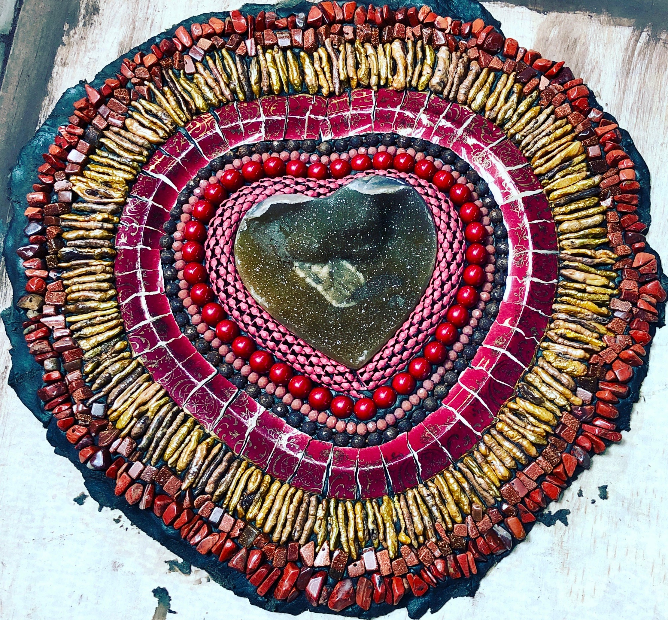 Using a rich red & golden palette, this piece begins to grow out from the center heart. I am combing interesting textures and colors together to create a warmth. As in life, the heart can blossom when nurtured with love.