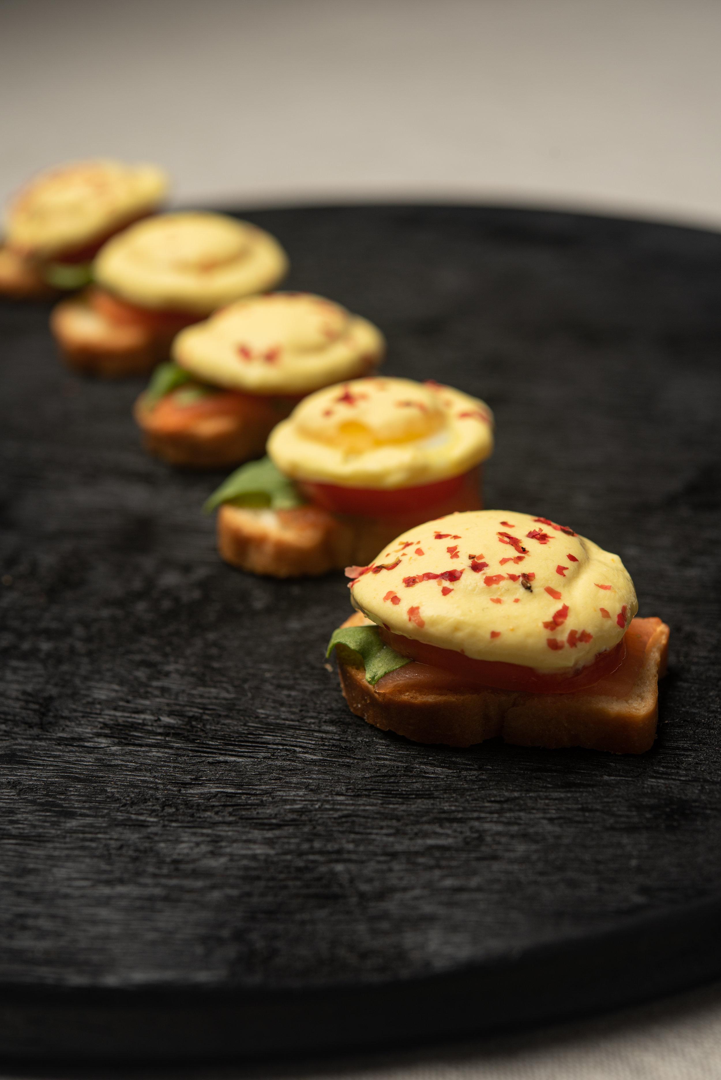 Eggs Benedict with Smoked Salmon, Quail Egg, Arugula, Tomato, Huancaina Sauce, Brioche.jpg