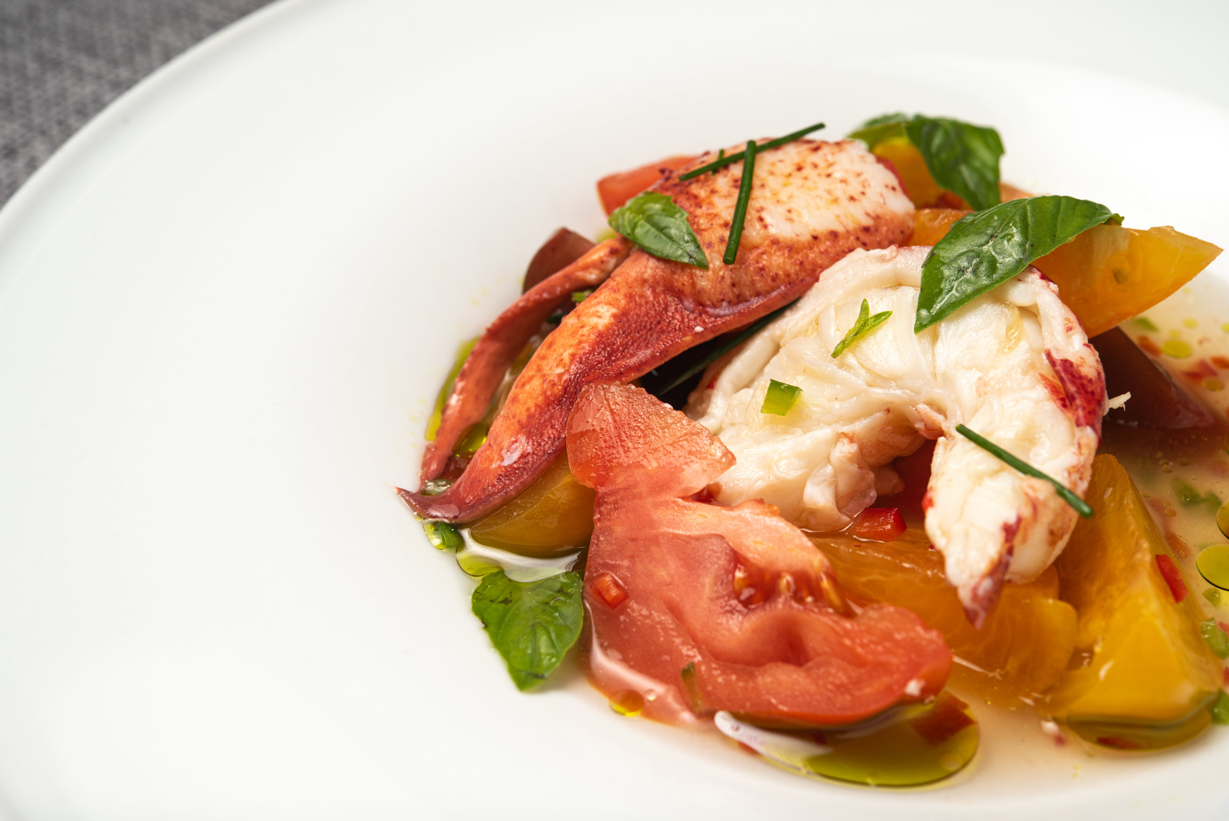 Maine Lobster & Tomatoes with Heirloom Tomatoes, Chiles, Fresh Horseradish Infused Tomato Consume, Herbs, Blossoms (1).jpg