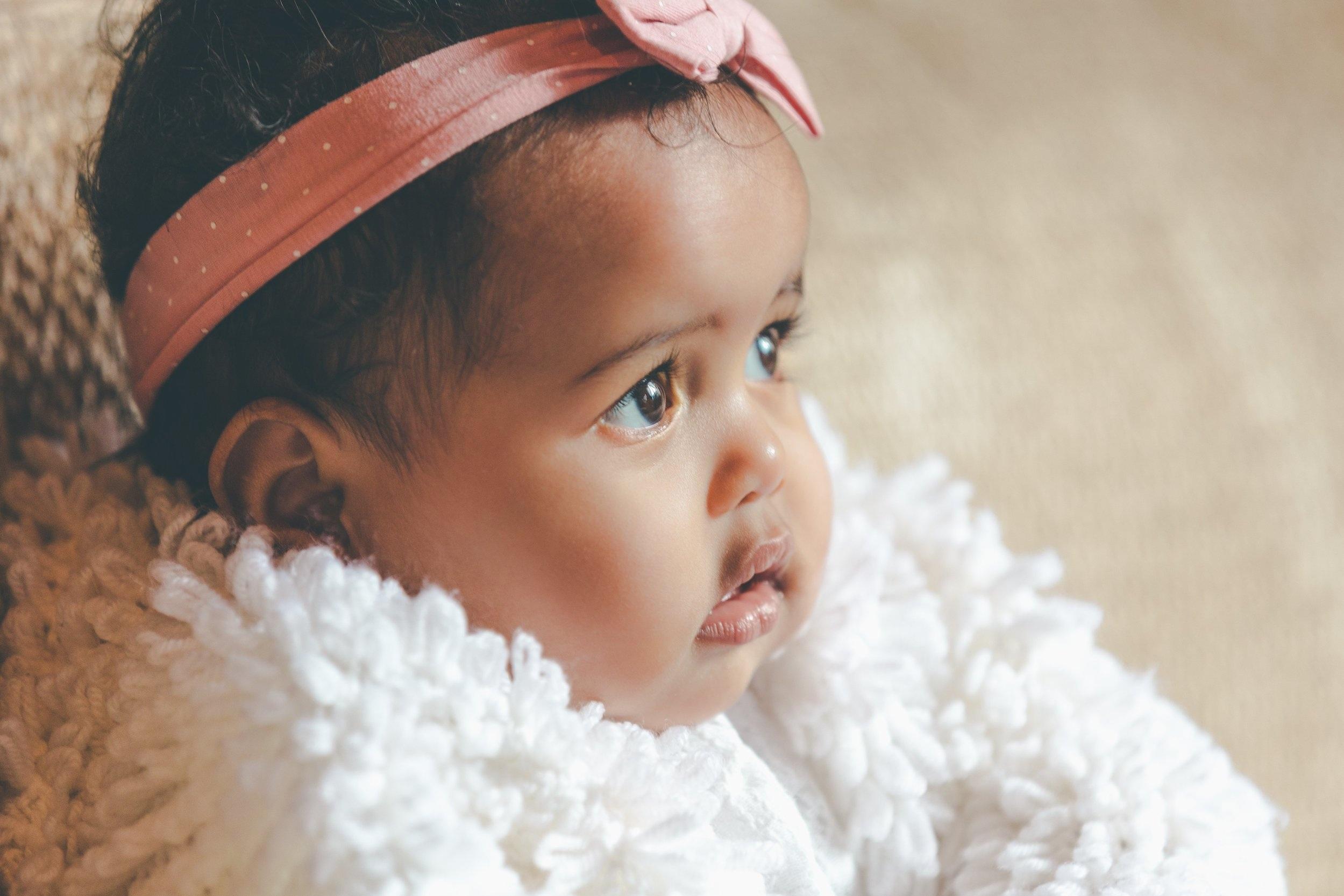 cute-baby-girl-with-pink-bow-headband.jpg