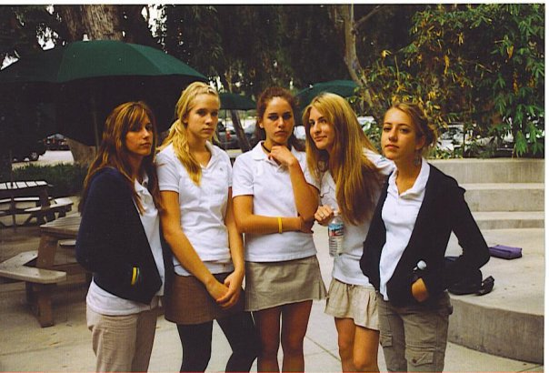 """A """"serious"""" uniform day. (Spot the Livestrong bracelets, navy Juicy jackets, and Lacoste polos.) I'm the happy one in the middle."""